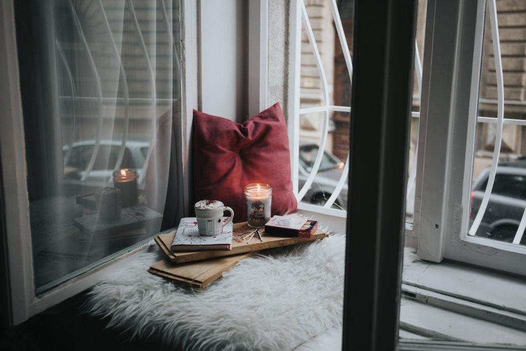 Create cozy pom pom pillows